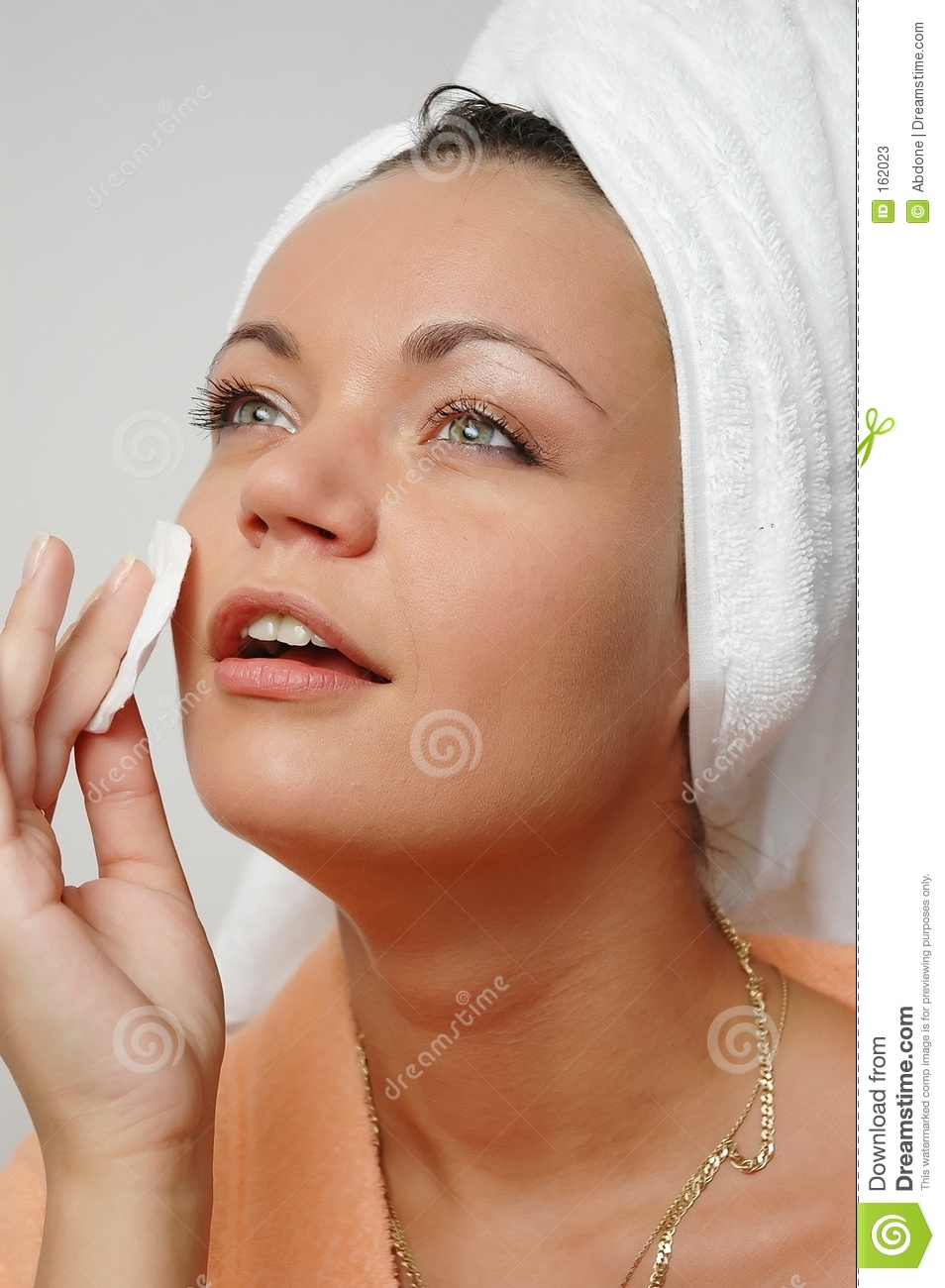 Woman with cotton pad