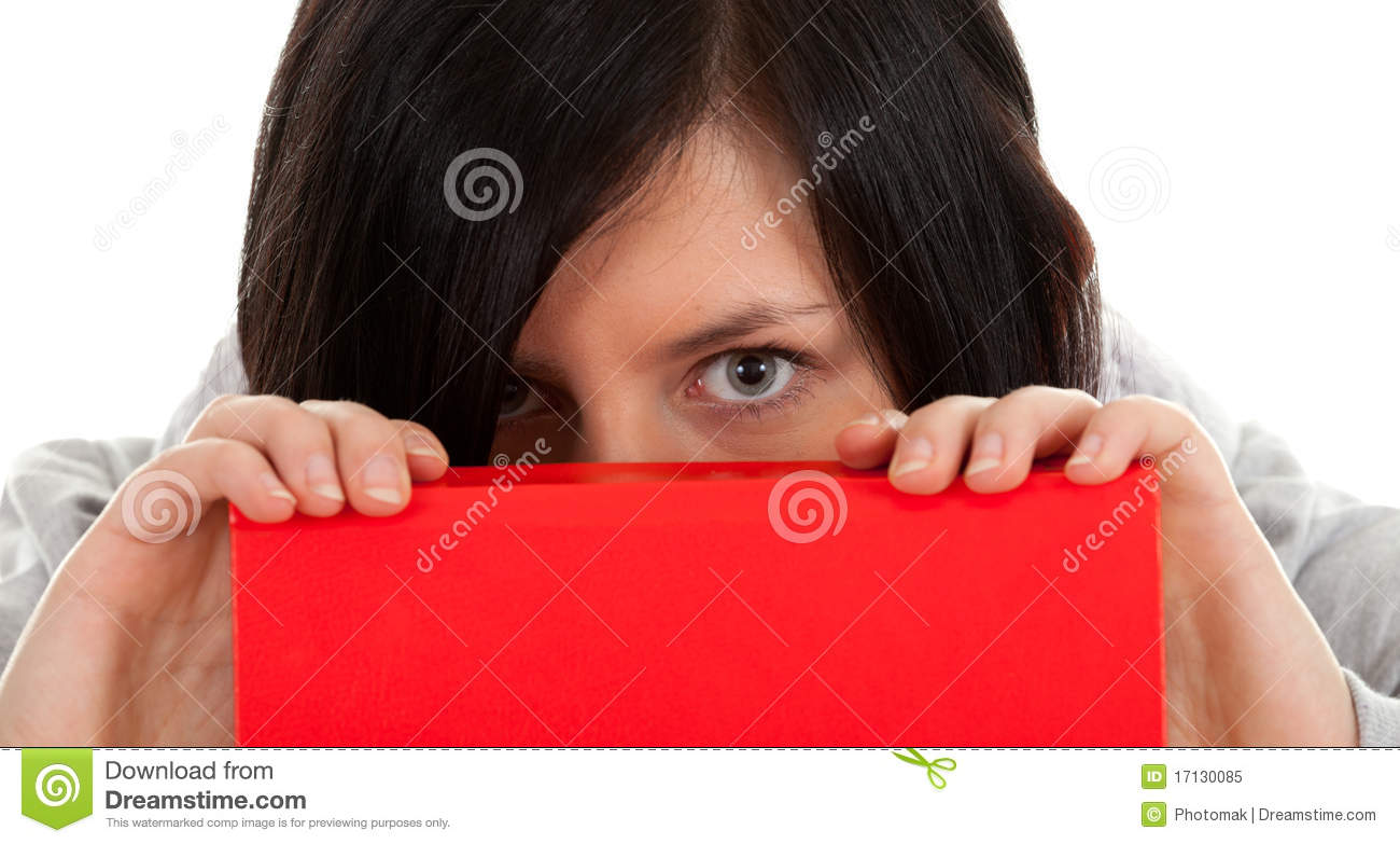 Book Covering Face : Woman covering face red book royalty free stock photo