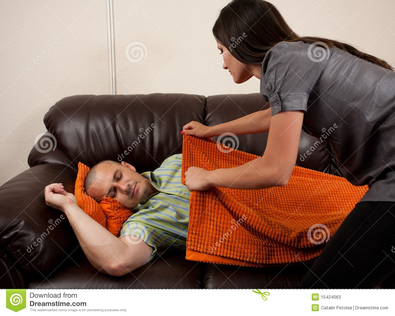 Woman Covering Her Husband With A Blanket Stock Image