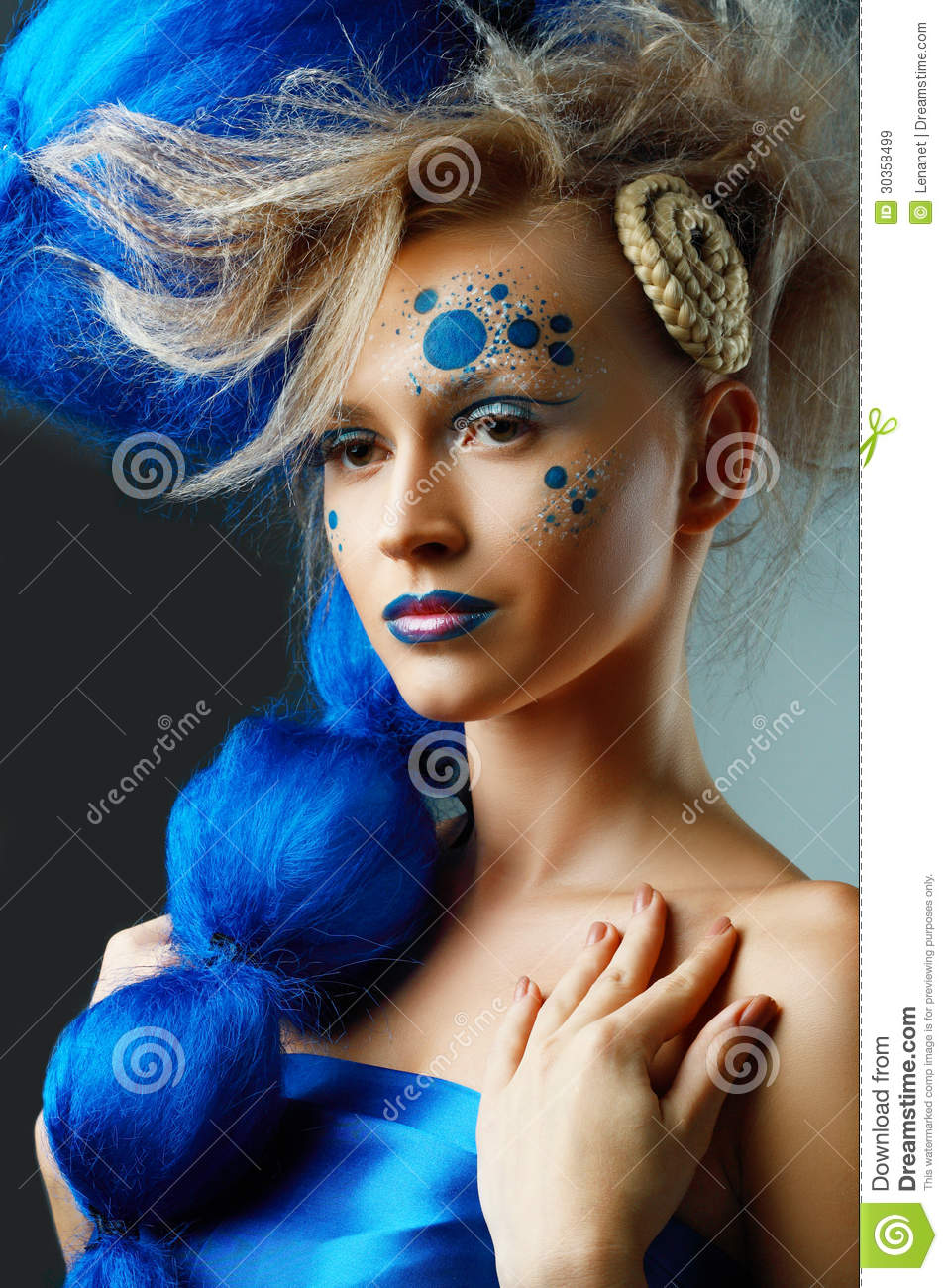 Beautiful fashionable young woman with creative fantasy hairstyle with ...