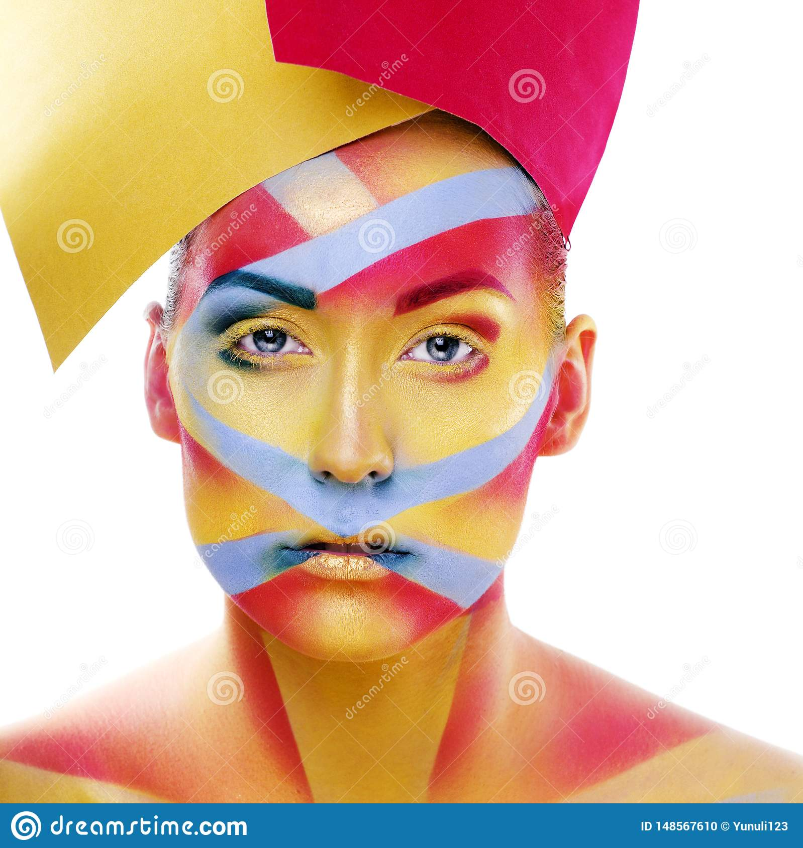Woman with creative geometry make up, red, yellow, blue closeup smiling colored, bright creative concept