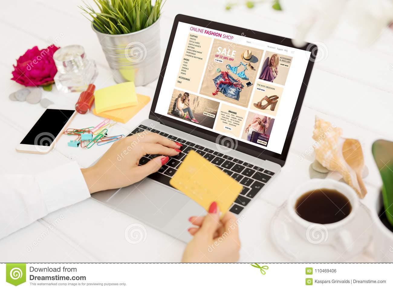 Woman with credit card buying new clothes online
