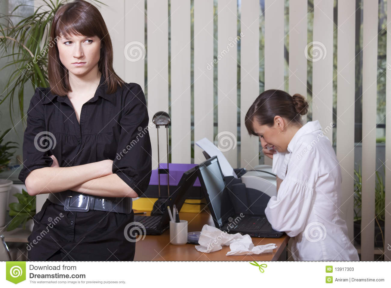 Woman crying in office