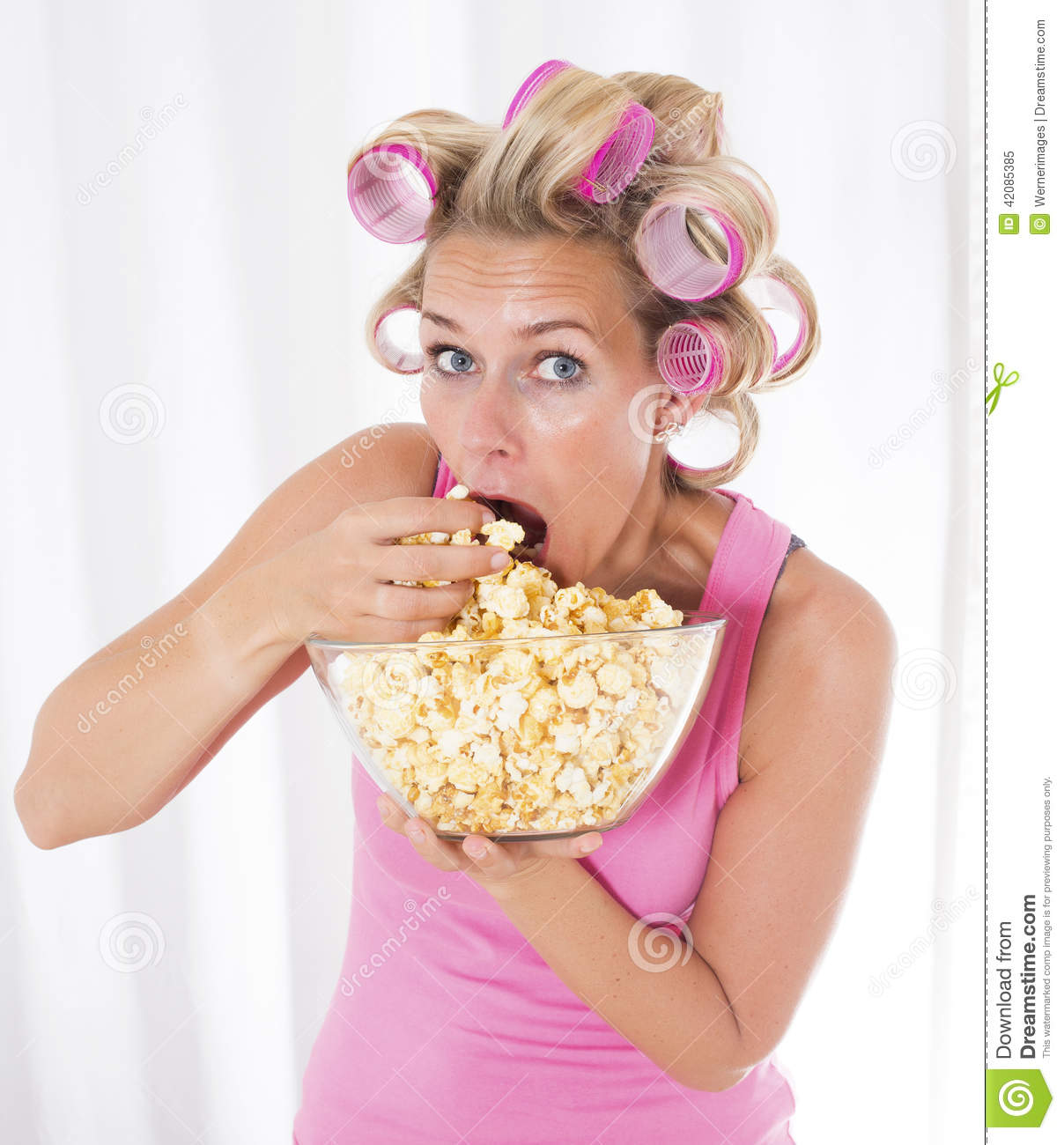 woman with curlers eating popcorn stock image image of hair