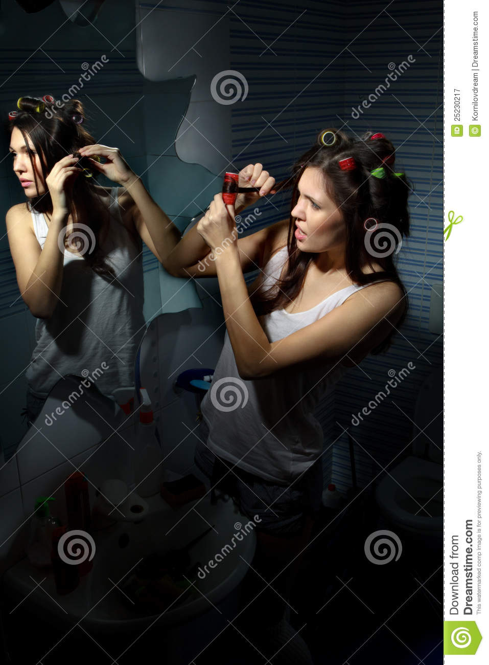 Woman curling her hair
