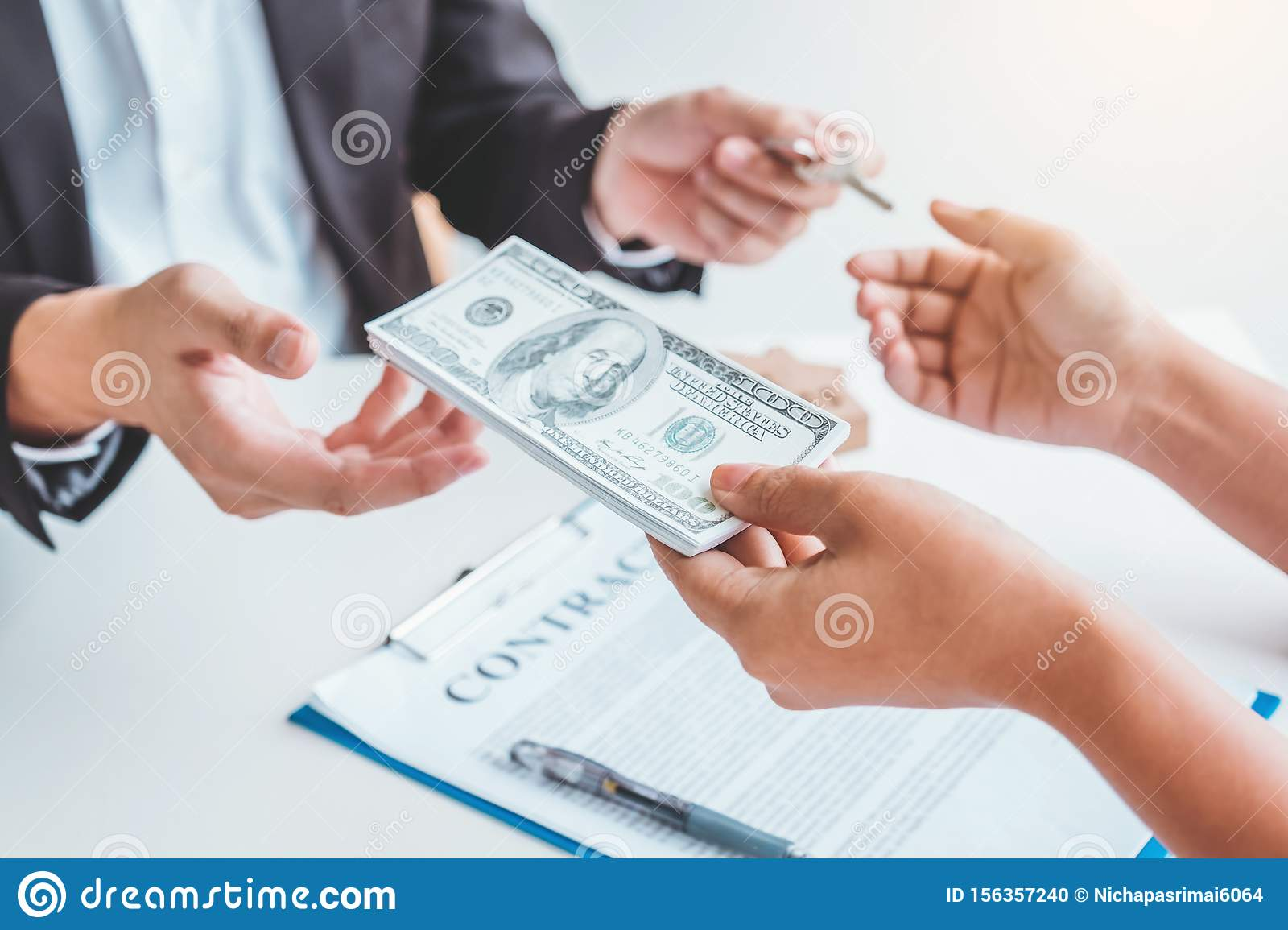 Woman customer sign agreement buying home ,salesman receive money after good deal after successful loan contract