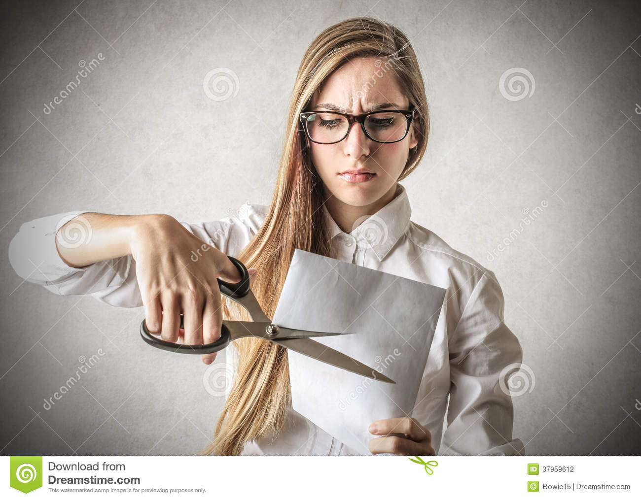 Cutting A Piece Of Paper : Woman cutting a piece of paper stock photo image