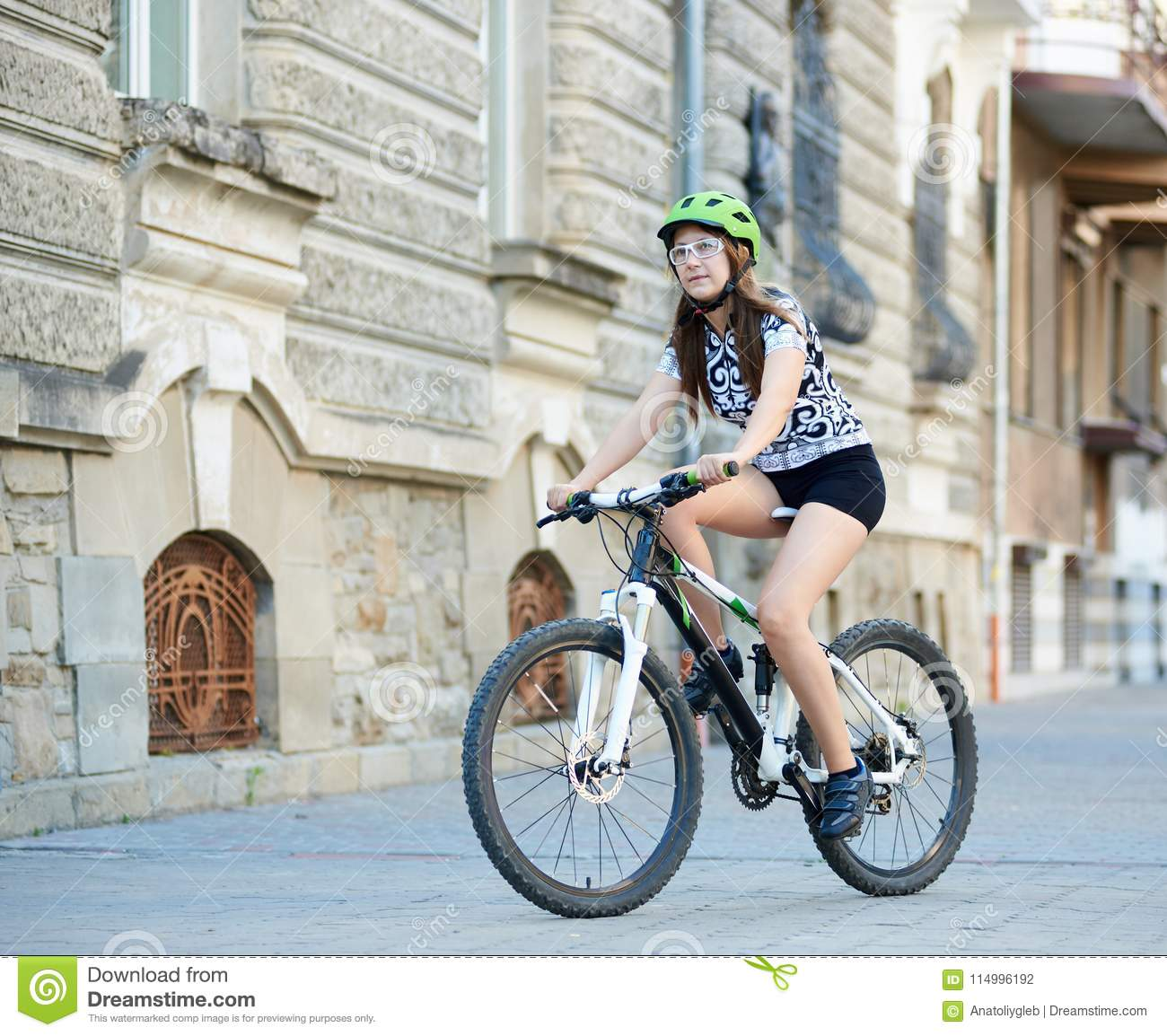 woman-cycling-down-paved-old-street-female-toned-cyclist-professional- clothing-helmet-riding-bike-streets-beautiful-114996192.jpg 5cda919d4
