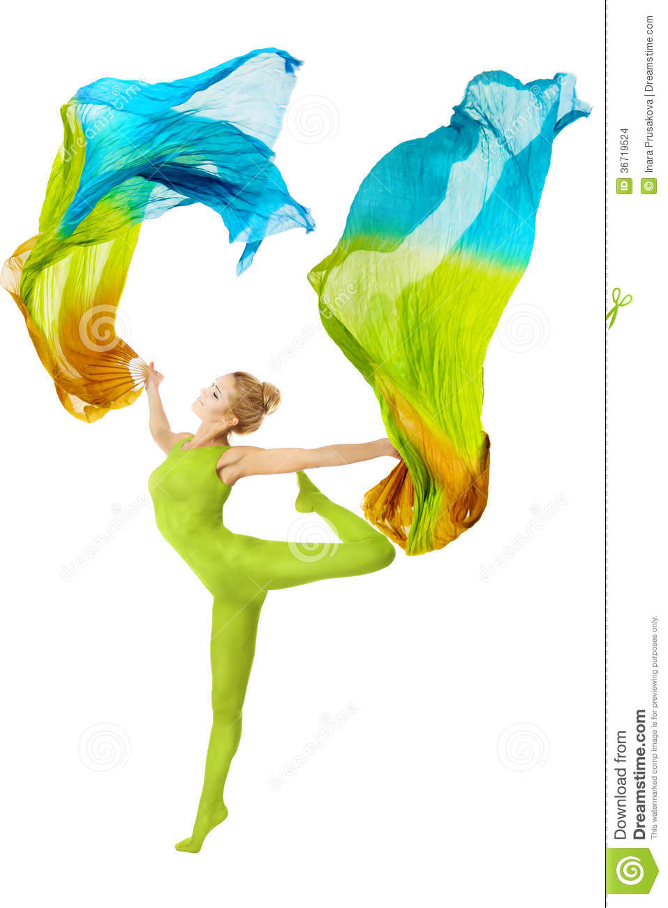 Woman dancing with fluttering flying colorful fabric over white