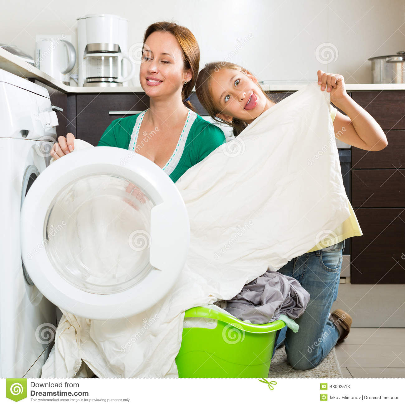 Woman with daughter near washing machine stock photo for Laundry home