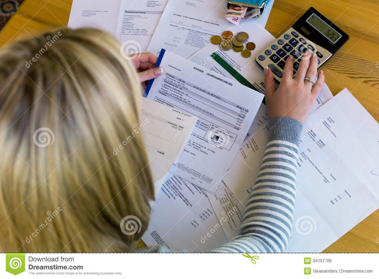 Woman with debts and bills