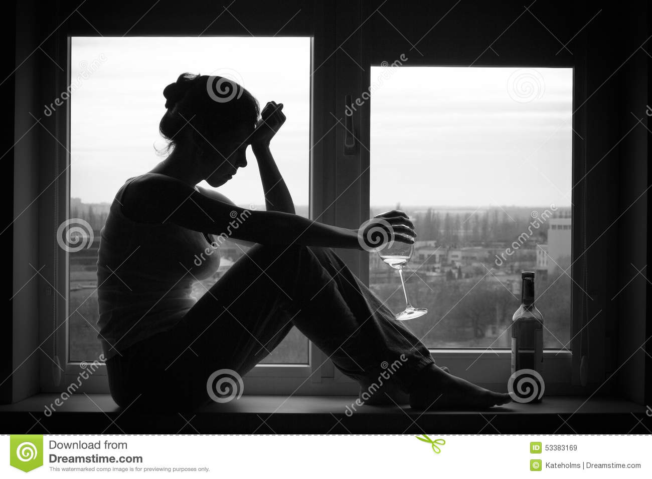 Sad young woman sitting on the window drinks wine alcoholism problem black and white photography