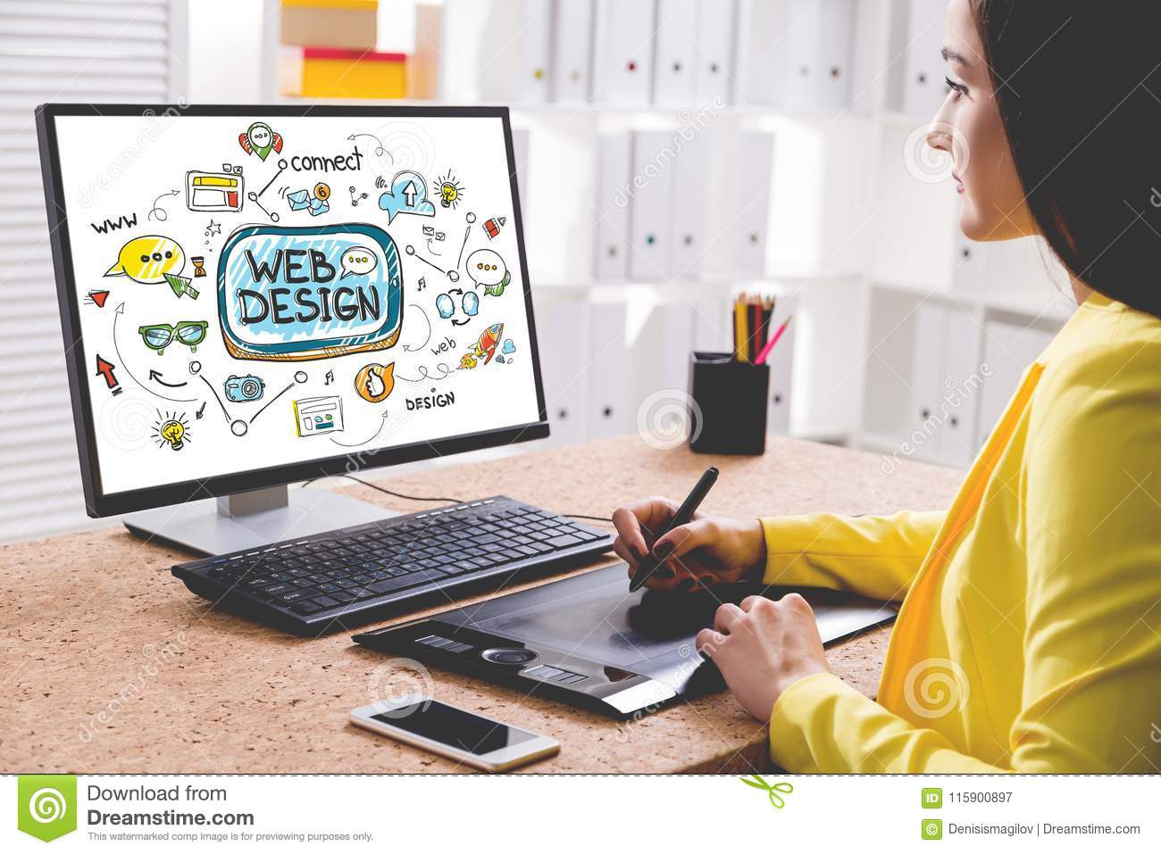 Woman designer drawing a web design sketch