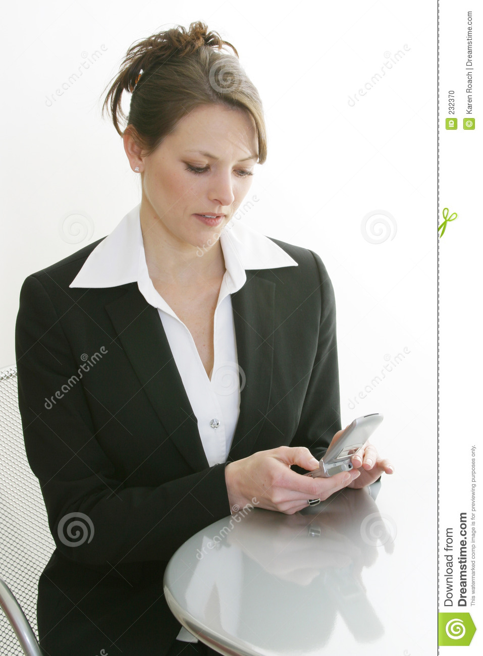 Woman dialing cell phone
