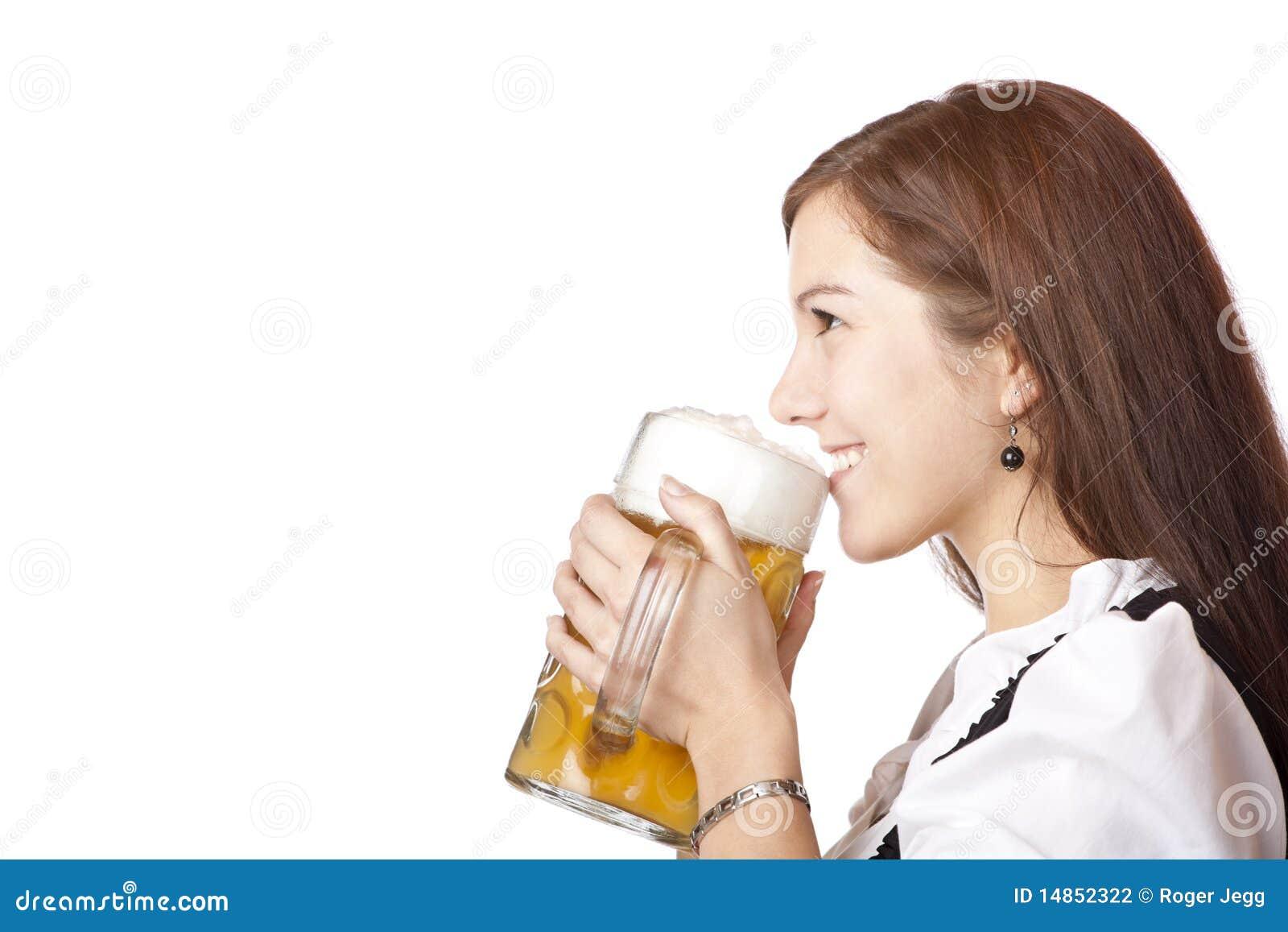 Woman in dirndl holds Oktoberfest beer stein
