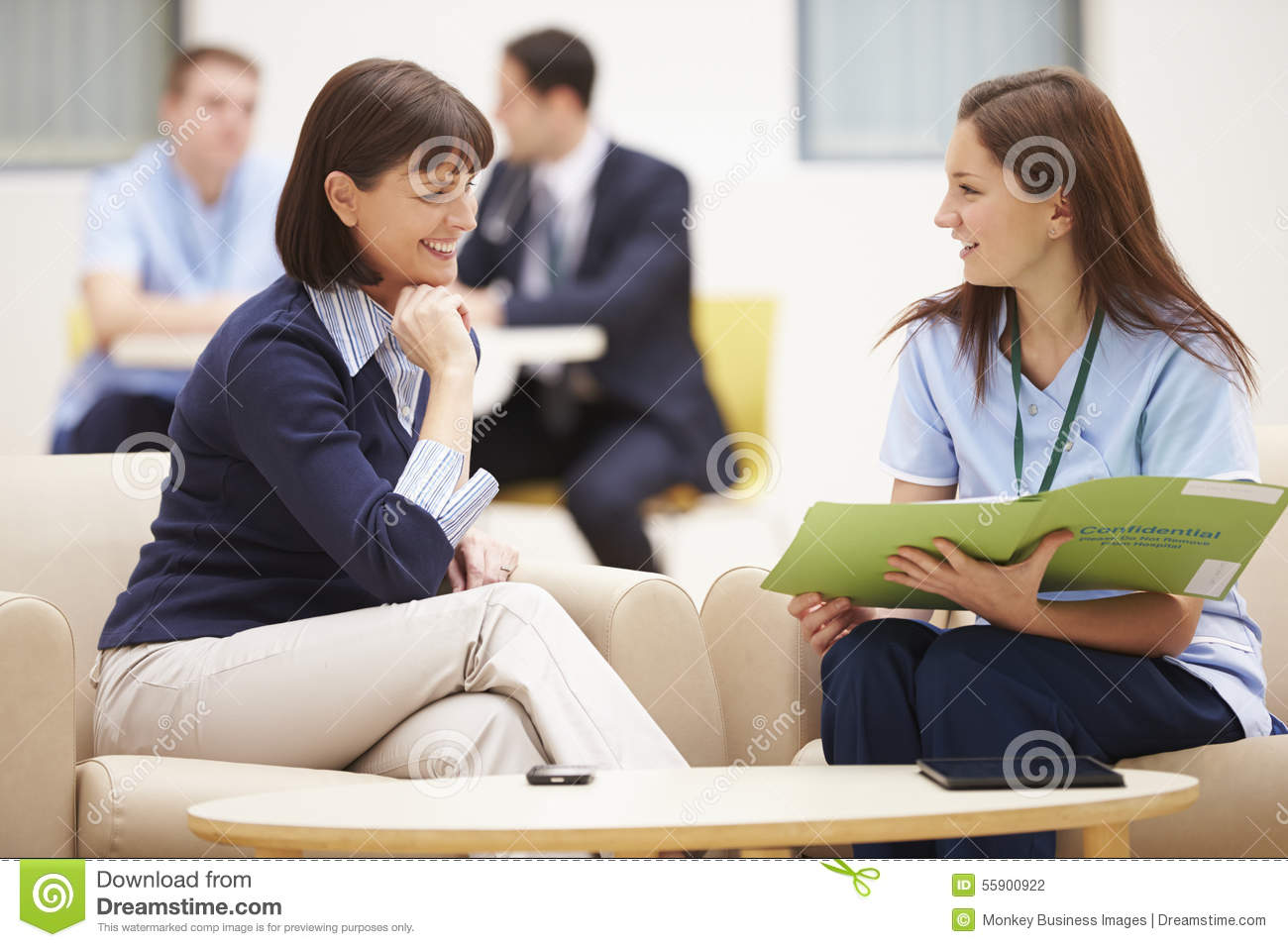 Woman Discussing Results With Nurse