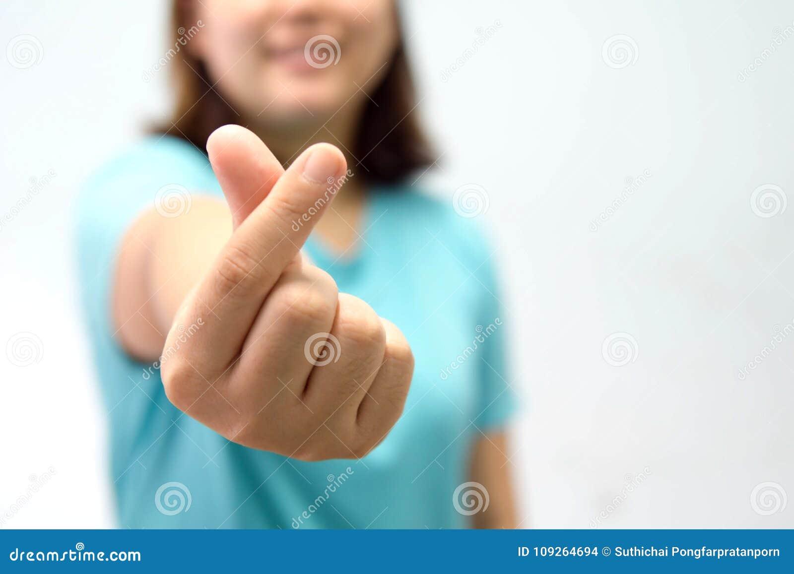 A woman do finger sign, call