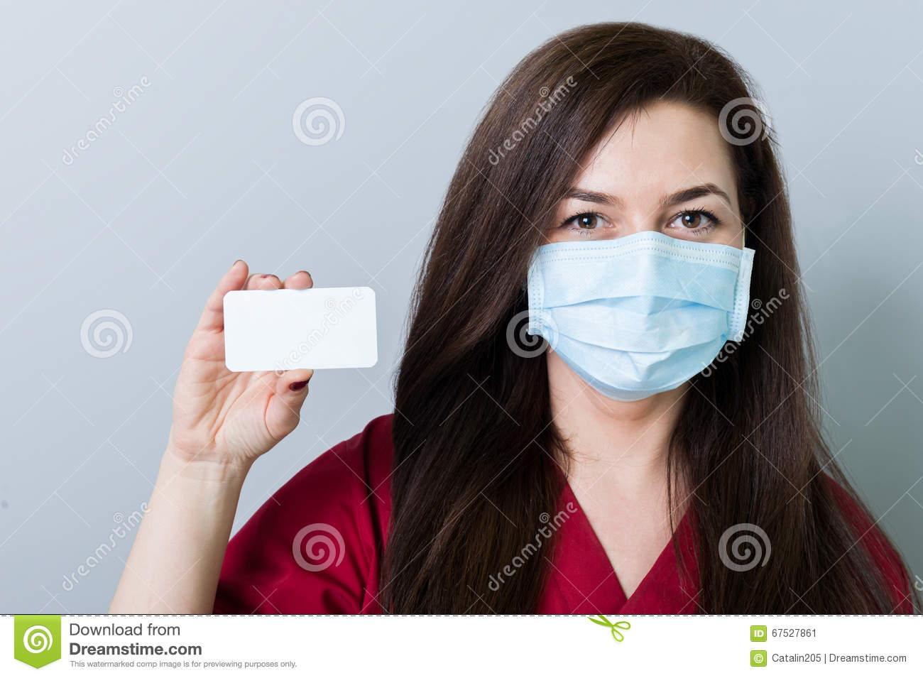 Woman doctor holding a blank white card