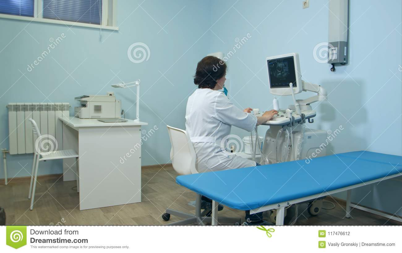 Woman doctor working at ultrasound diagnostic machine