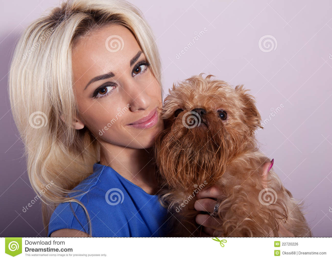 Young woman with a dog breed Griffon Bruxellois.