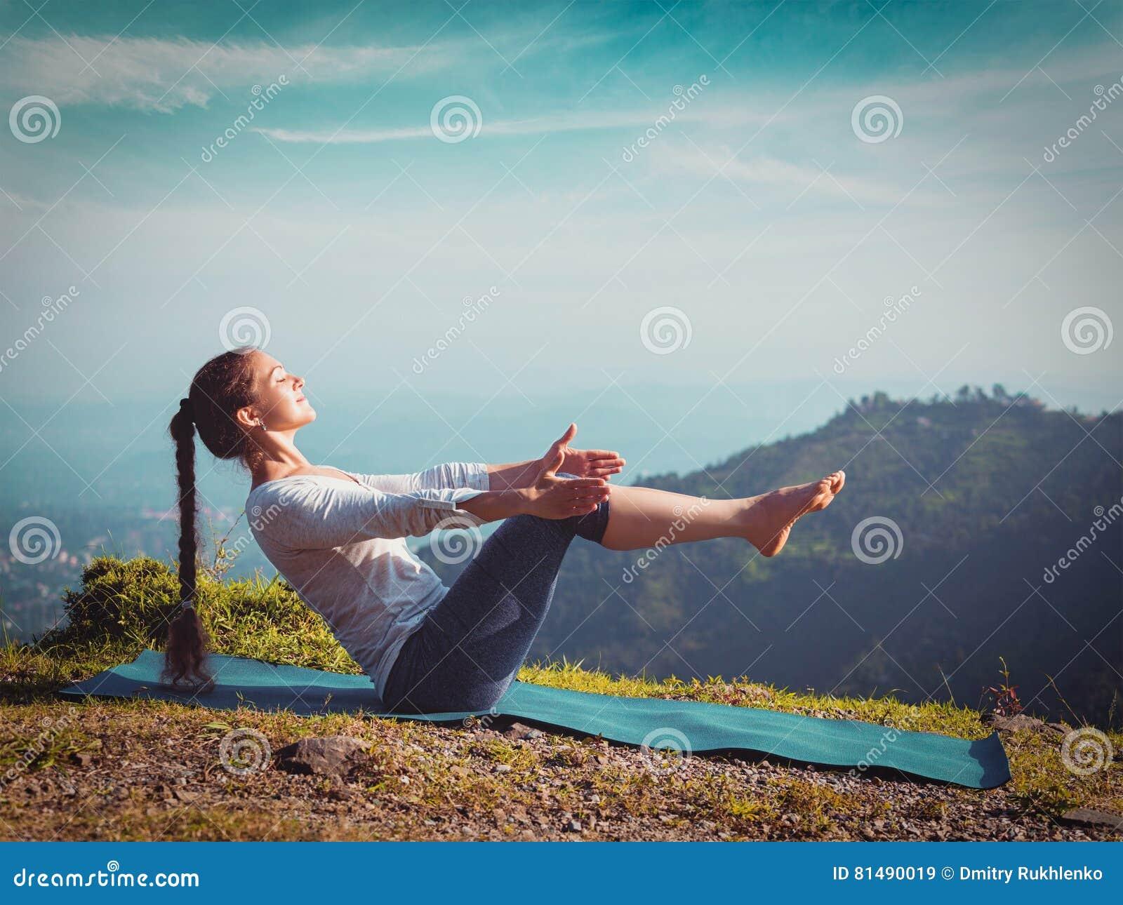 Woman Doing Ashtanga Vinyasa Yoga Asana Navasana - Boat ...