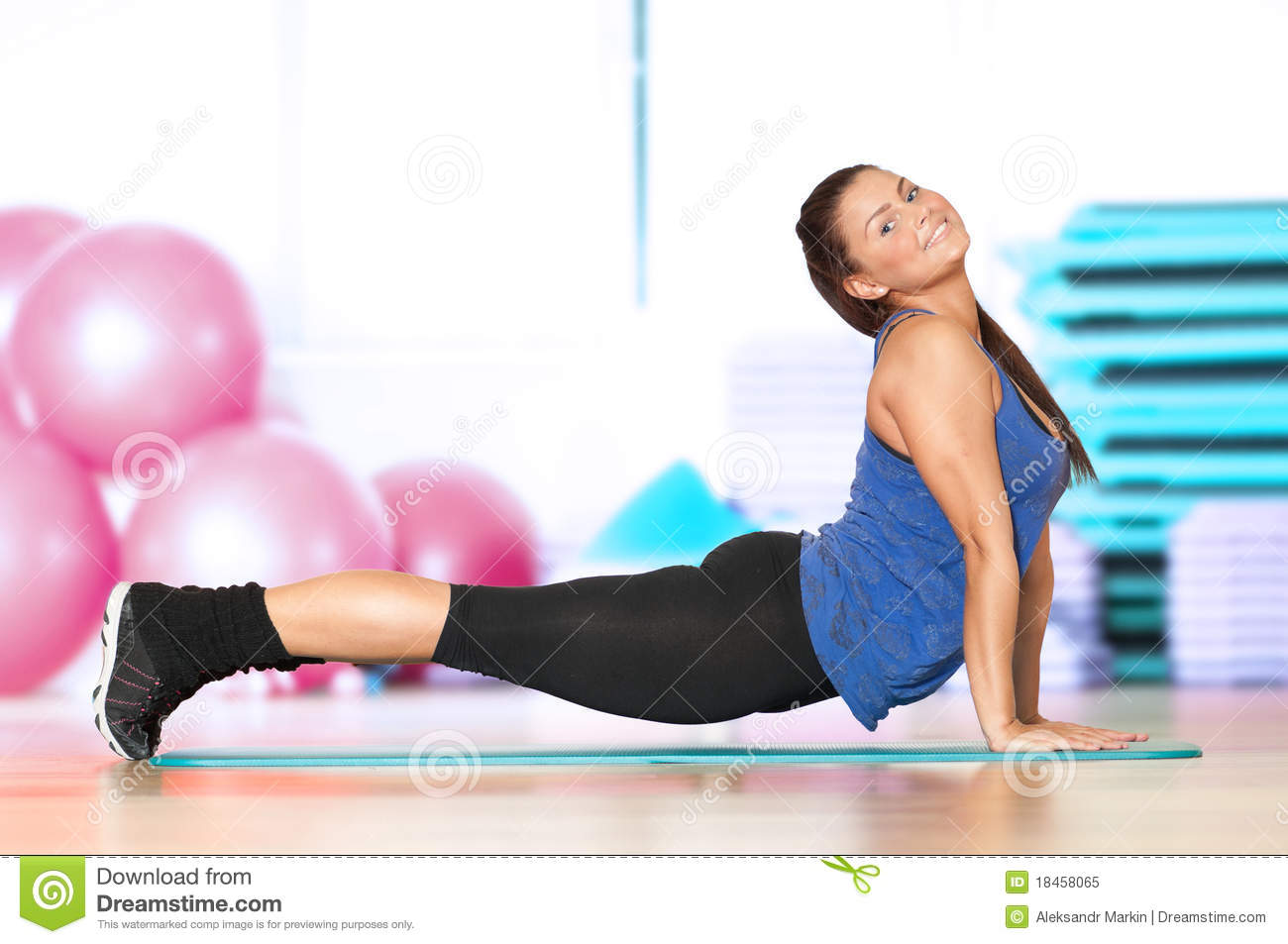 Woman doing fitness exercise at sport gym royalty free for Gimnasio sport gym