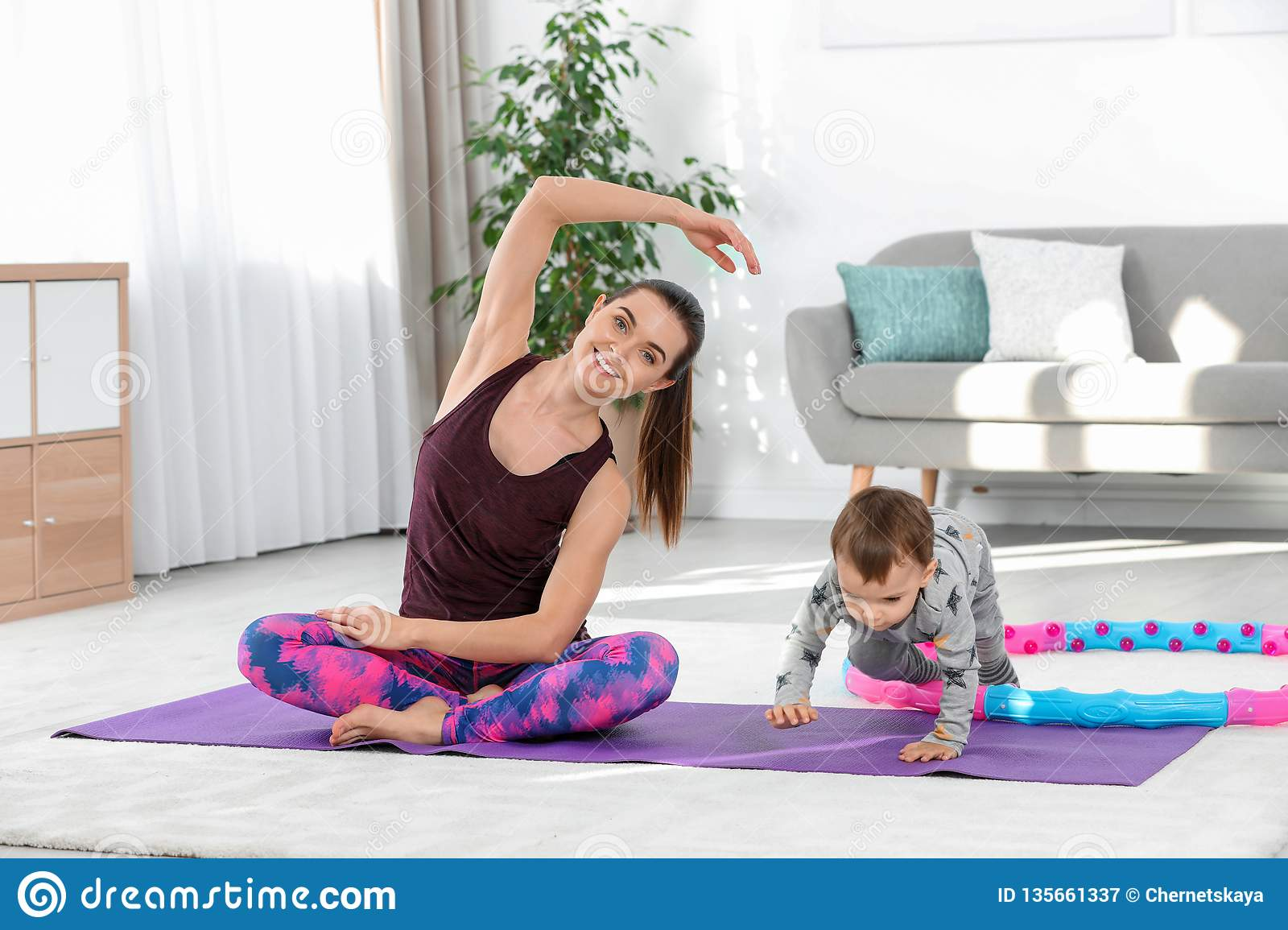 Woman doing fitness exercises together with son
