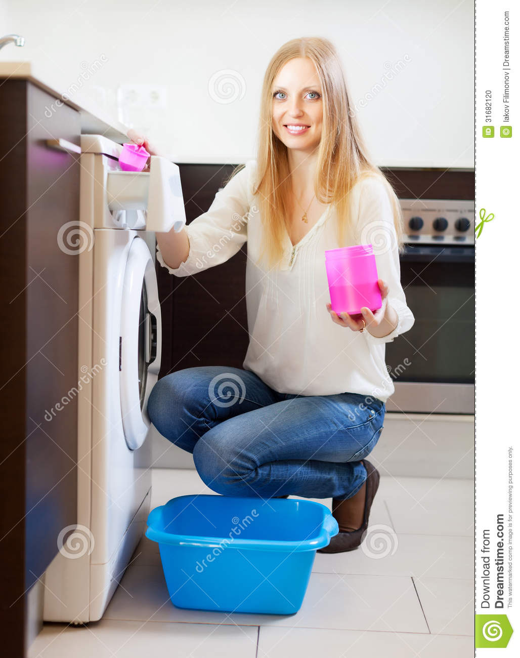 Woman Doing Laundry With Detergent Stock Photo - Image: 31682120