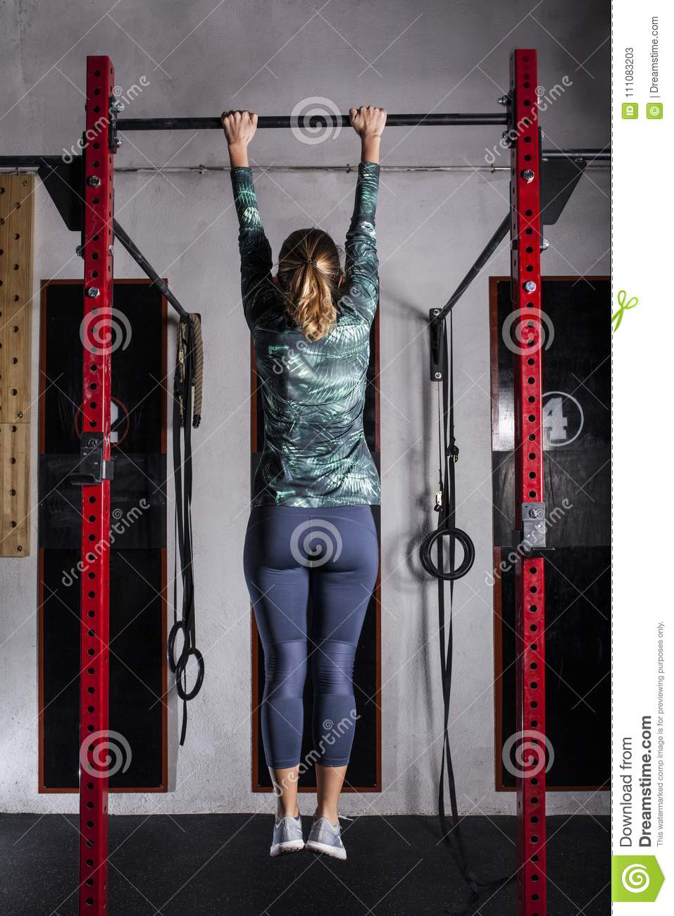 Woman training pull-up