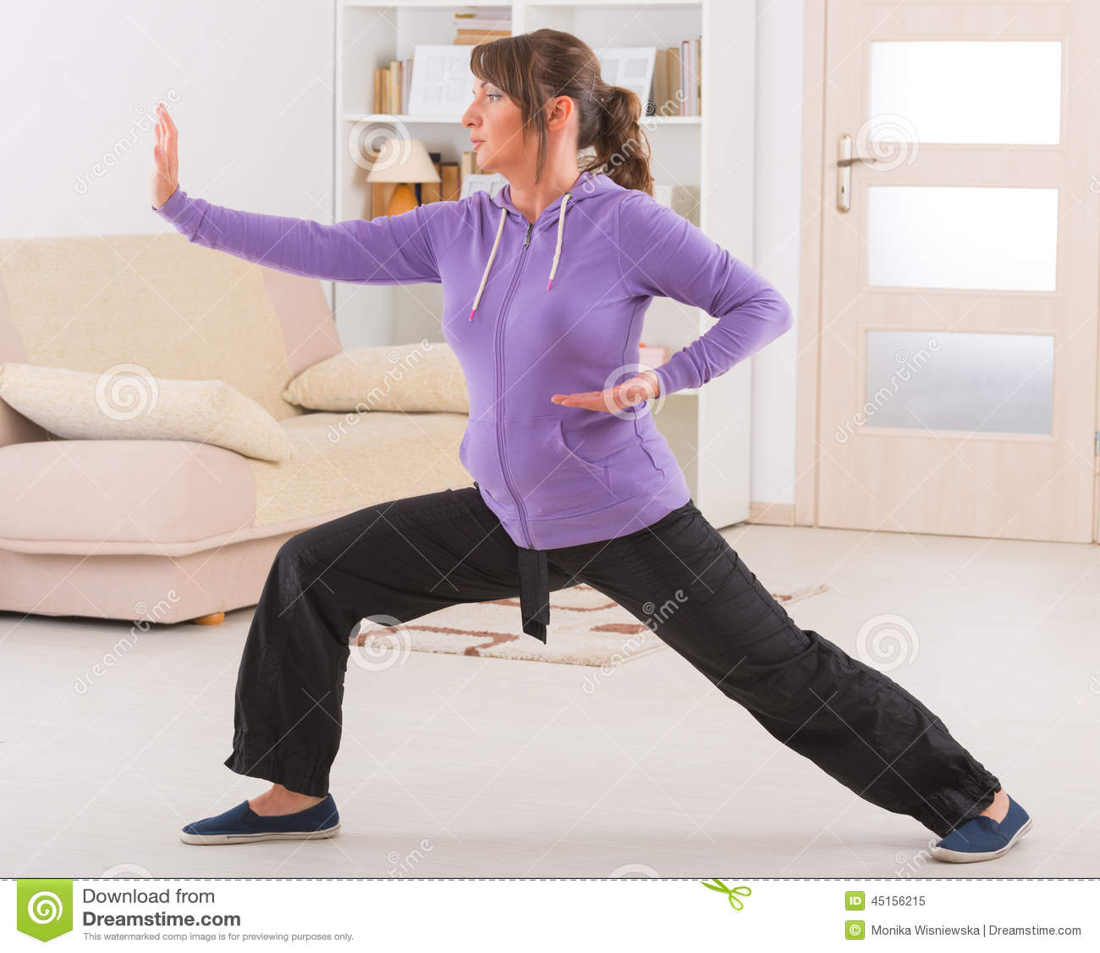Woman Doing Qi Gong Tai Chi Exercise Stock Photo - Image: 45156215