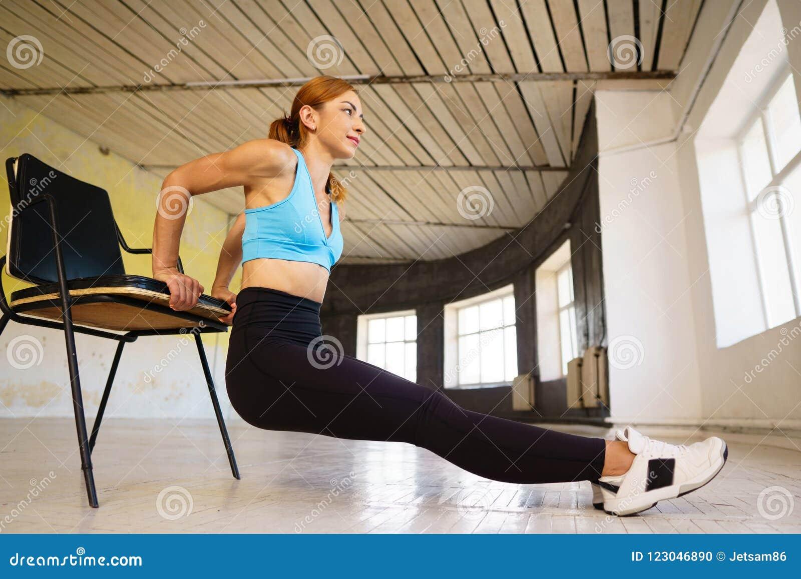Woman Doing Reverse Push Ups Using Chair Stock Photo - Image