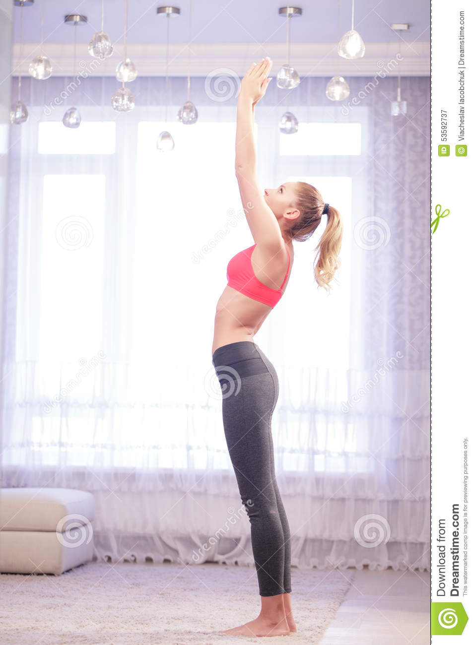 Woman doing sun salutation yoga pose stock image image of woman doing sun salutation yoga pose kristyandbryce Images