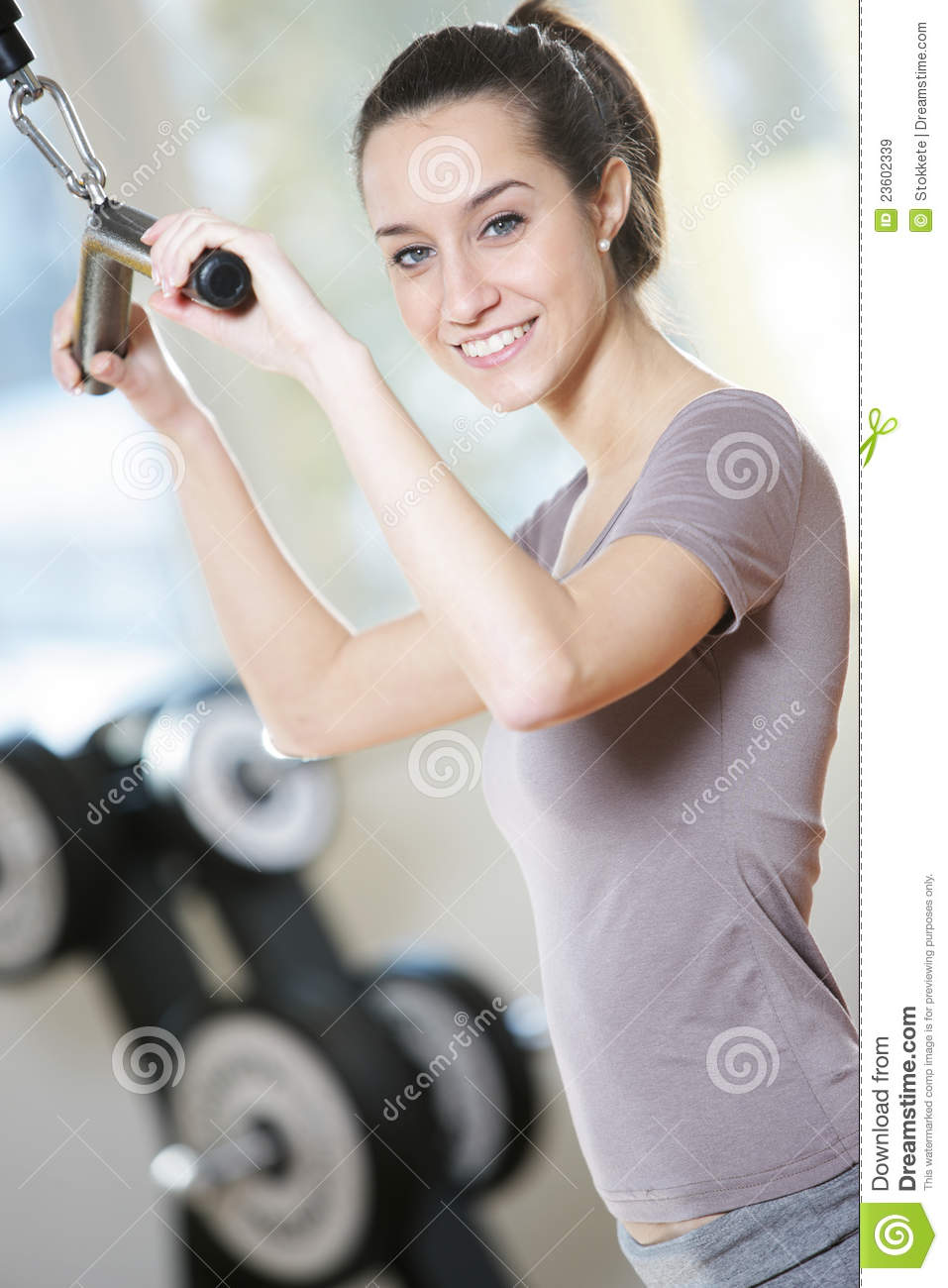 Woman doing on a weight machine at the health club