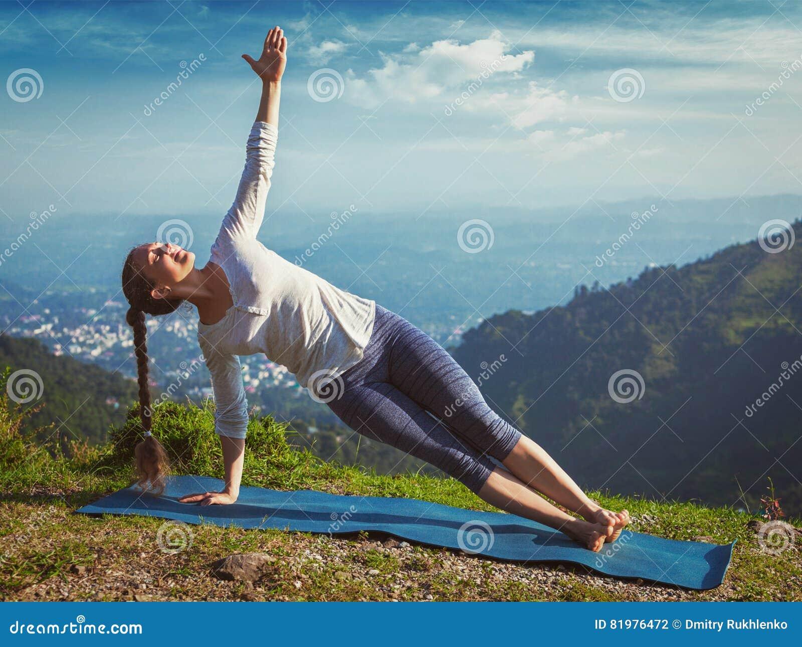 Woman Doing Yoga Asana Vasisthasana - Side Plank Pose ...