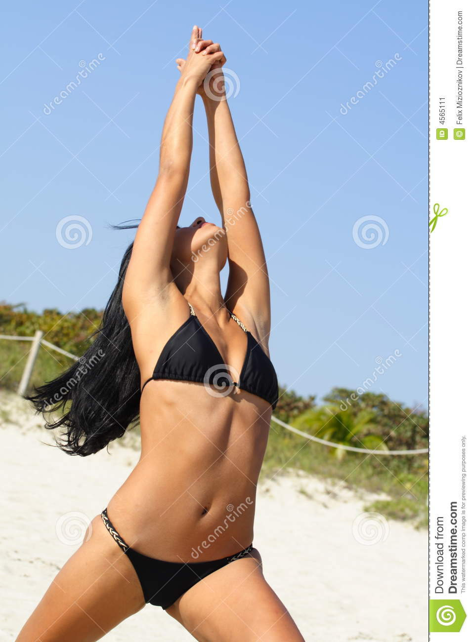 Woman Doing Yoga On The Beach Stock Image - Image: 4565111