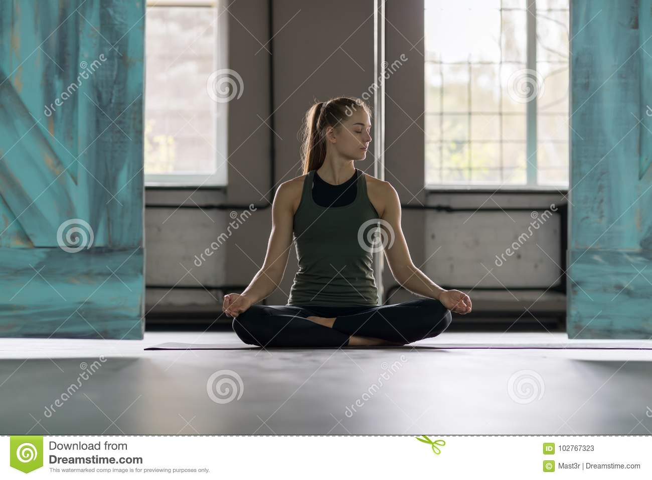 Woman Doing Yoga Exercises In Gym, Sport Fitness Girl Training Stretching