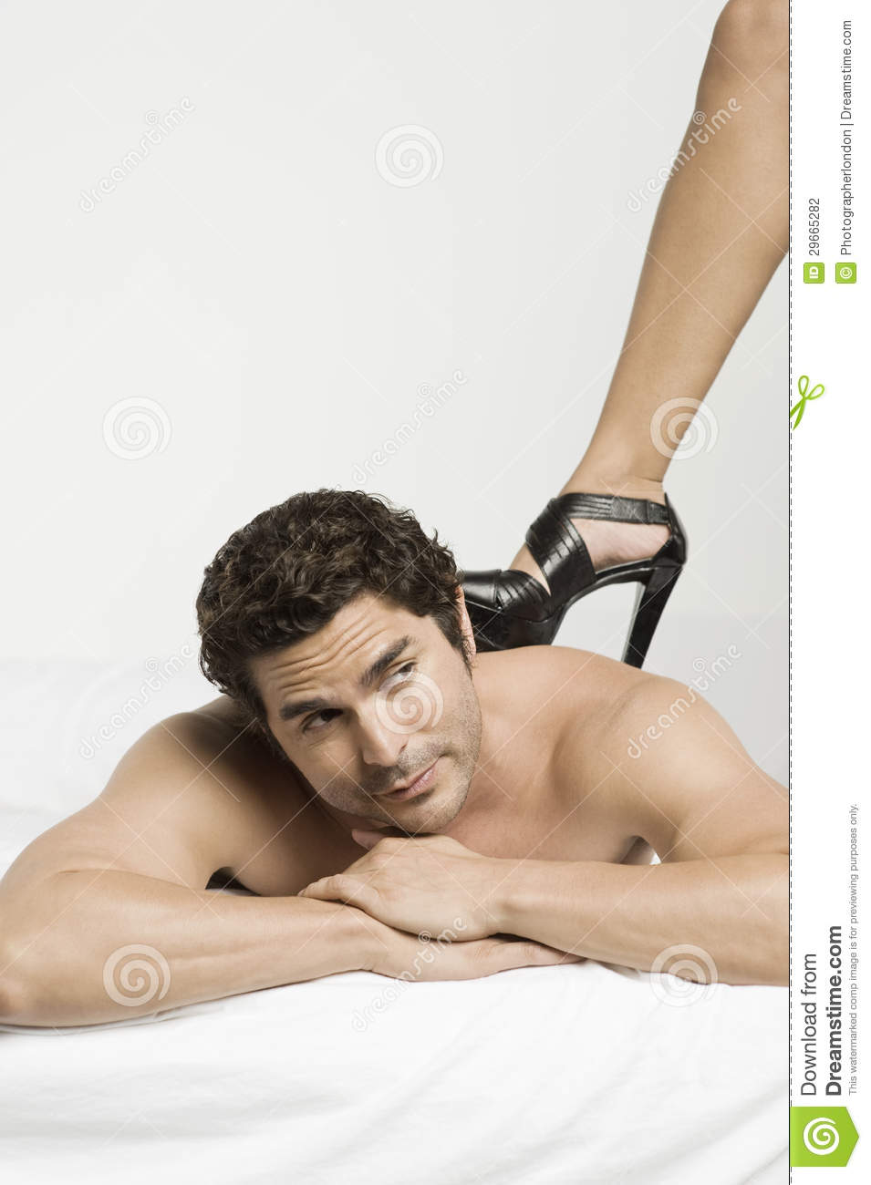women dominating men on bed