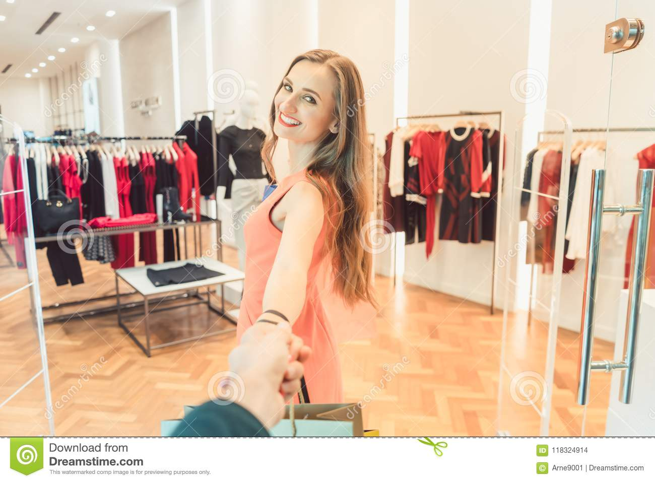 4164b252d Woman Dragging Her Man To Fashion Shopping In Boutique Or Store ...