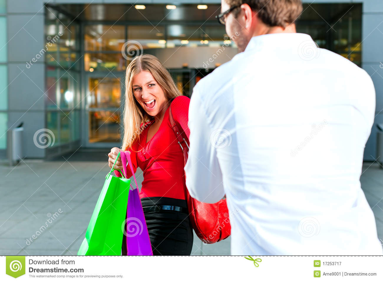 Woman Dragging Man Into Shopping Mall Royalty Free Stock