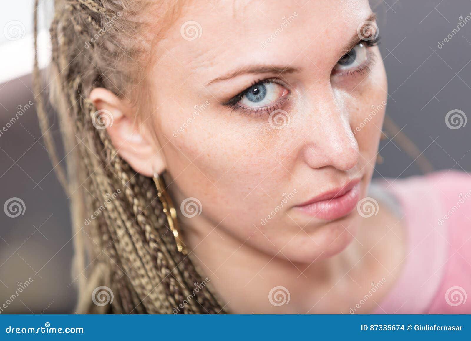 Woman on dreadlocks intense look