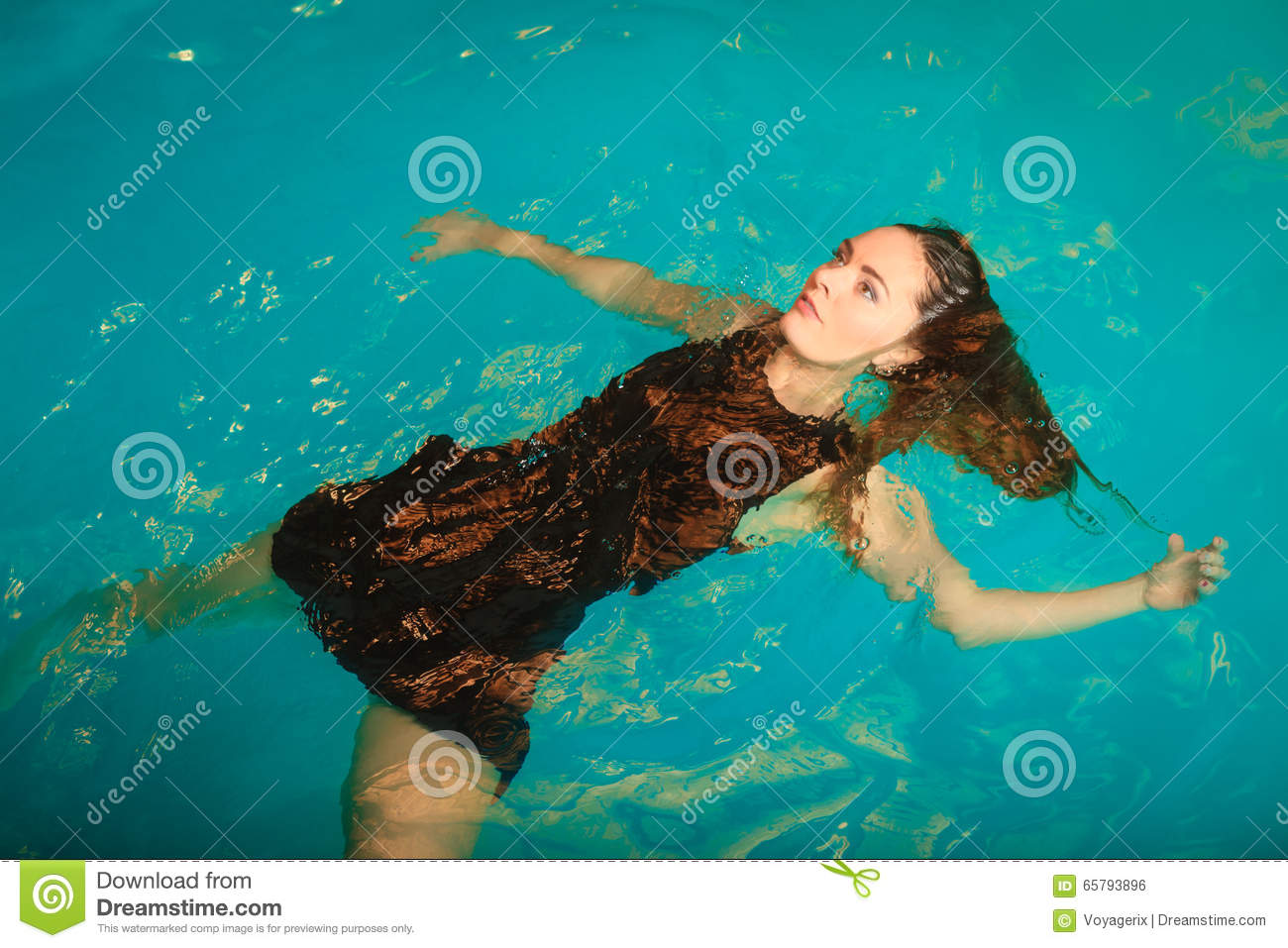 Woman dreaming relaxing in swimming pool water stock - What do dreams about swimming pools mean ...