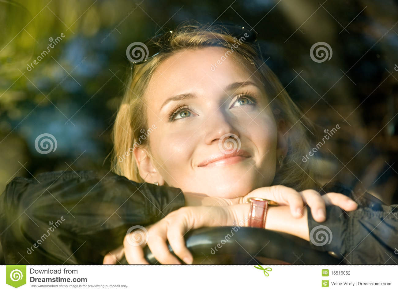 Woman dreams in the new car