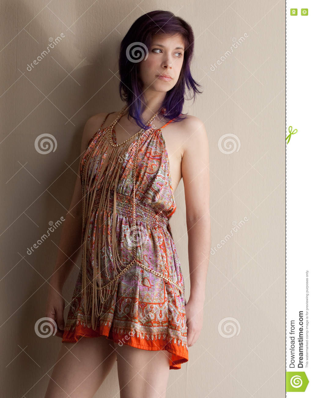 Woman in Dress and Cross Body Gold Chain Jewelry