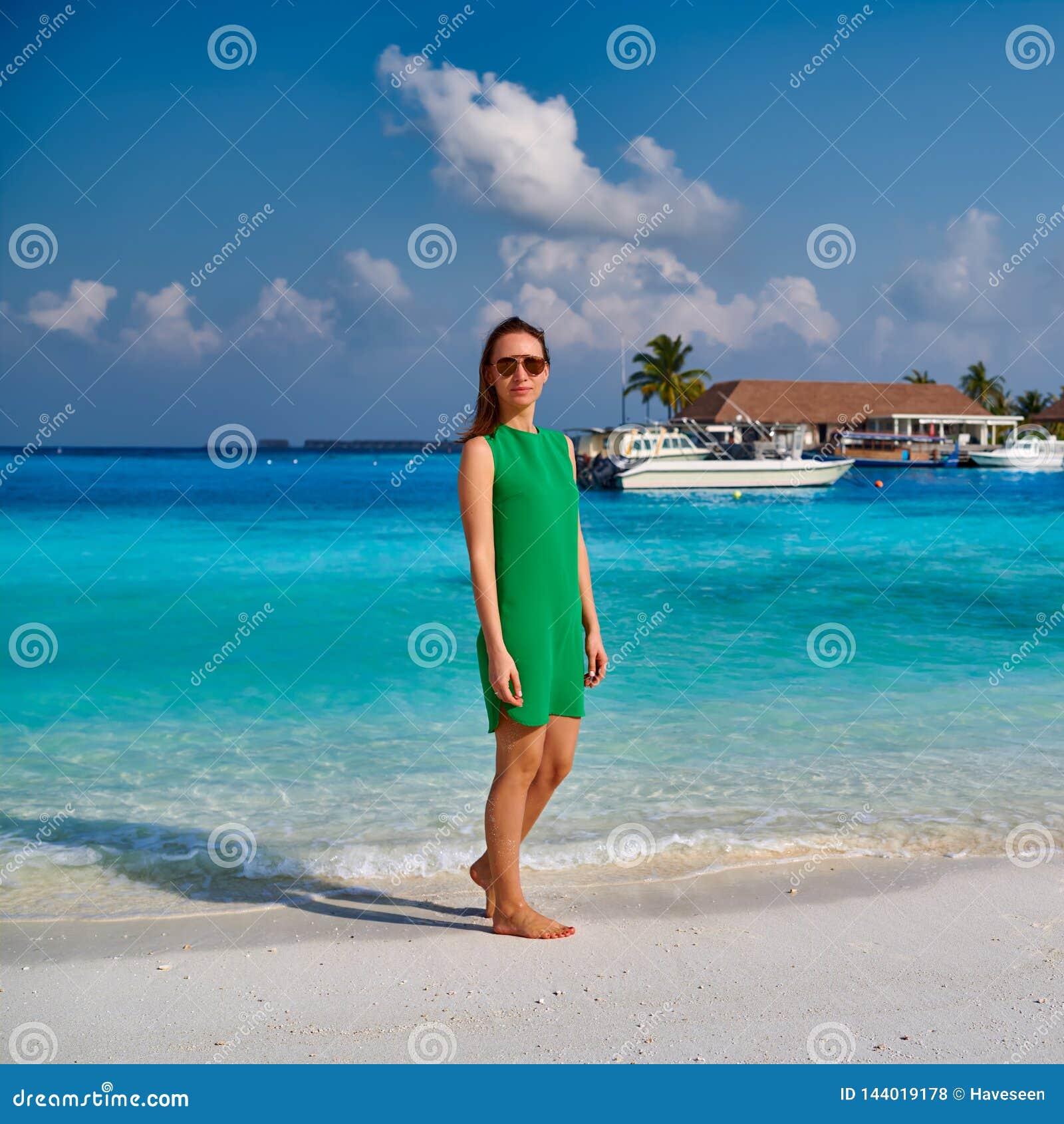 Woman In Dress Walking On Tropical Beach Stock Photo