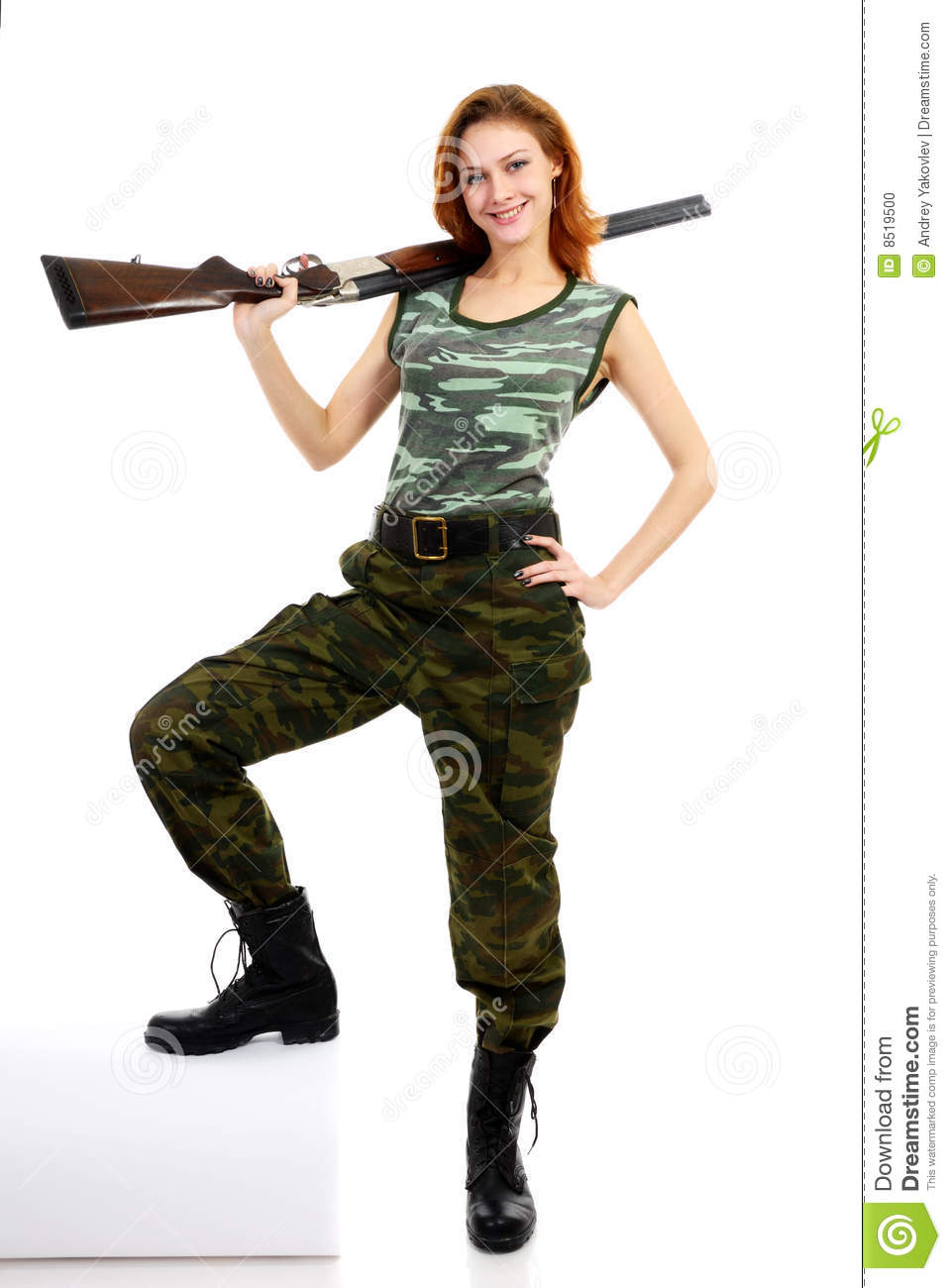 Woman dressed in green camouflage clothing and armed with double