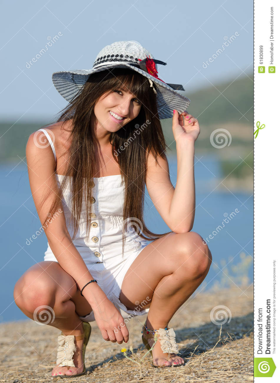 Woman dressed with white coveralls rompers joying the sunny day