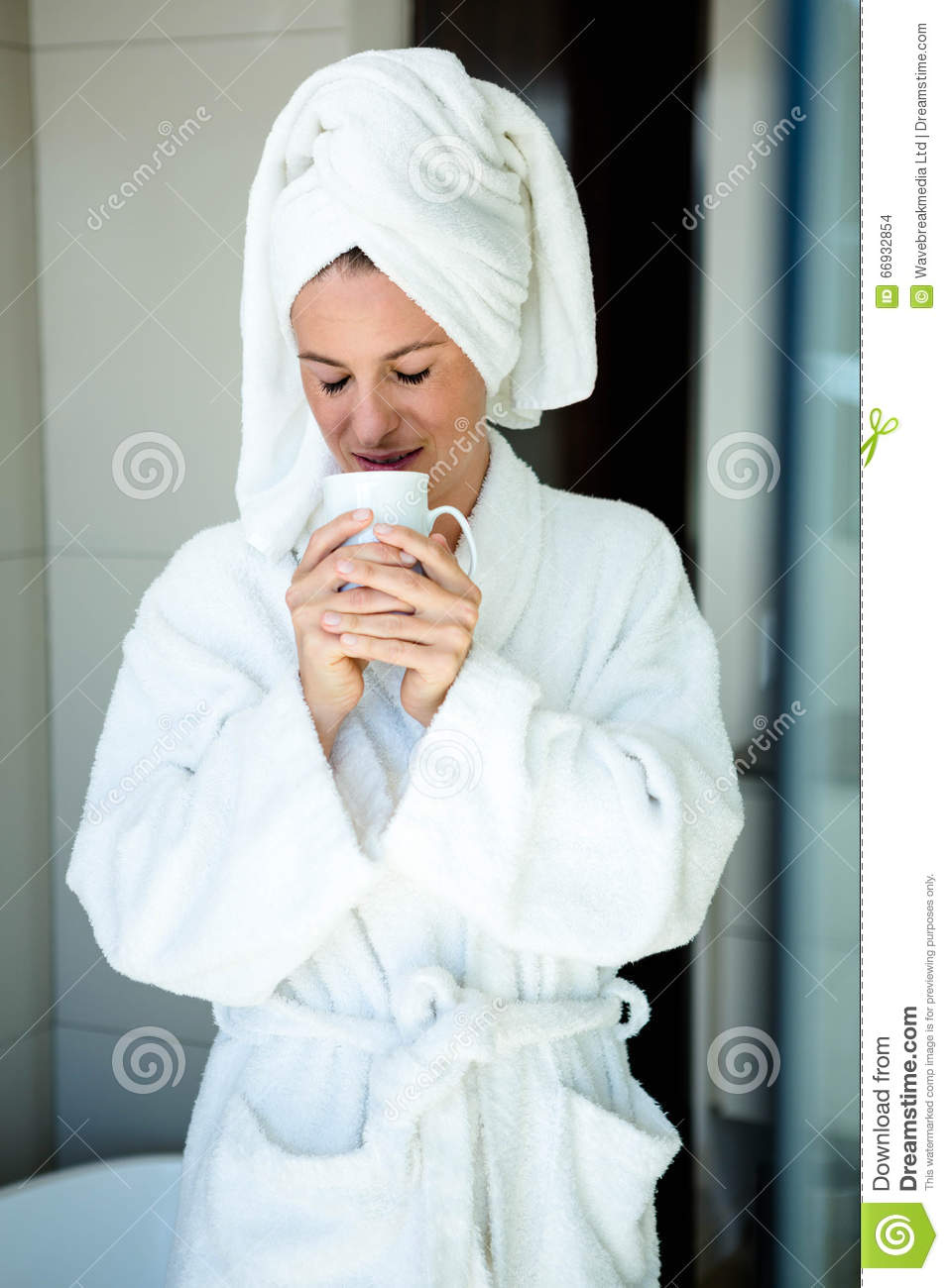 Woman In A Dressing Gown Drinking A Cup Of Coffee Stock Photo ...