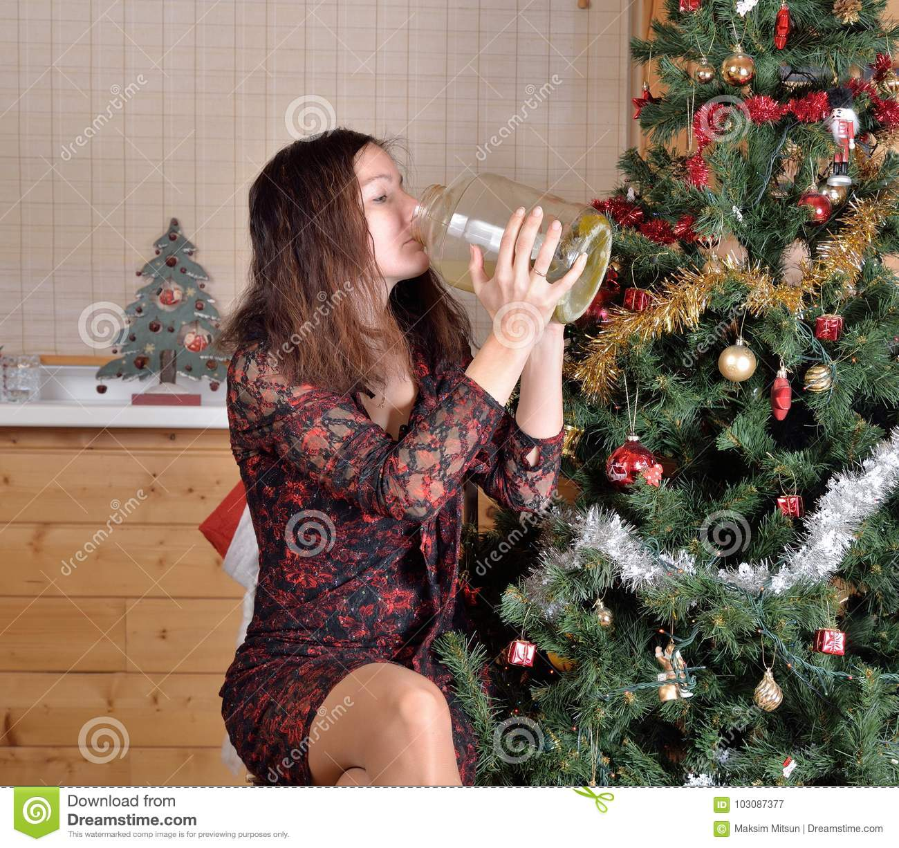 Woman Drinking Pickle Juice From The Jar At The Christmas Tree Stock