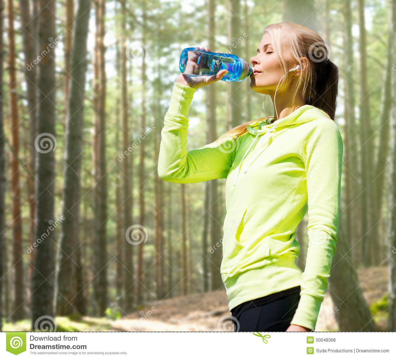 Woman Drinking Water After Doing Sports Outdoors Stock
