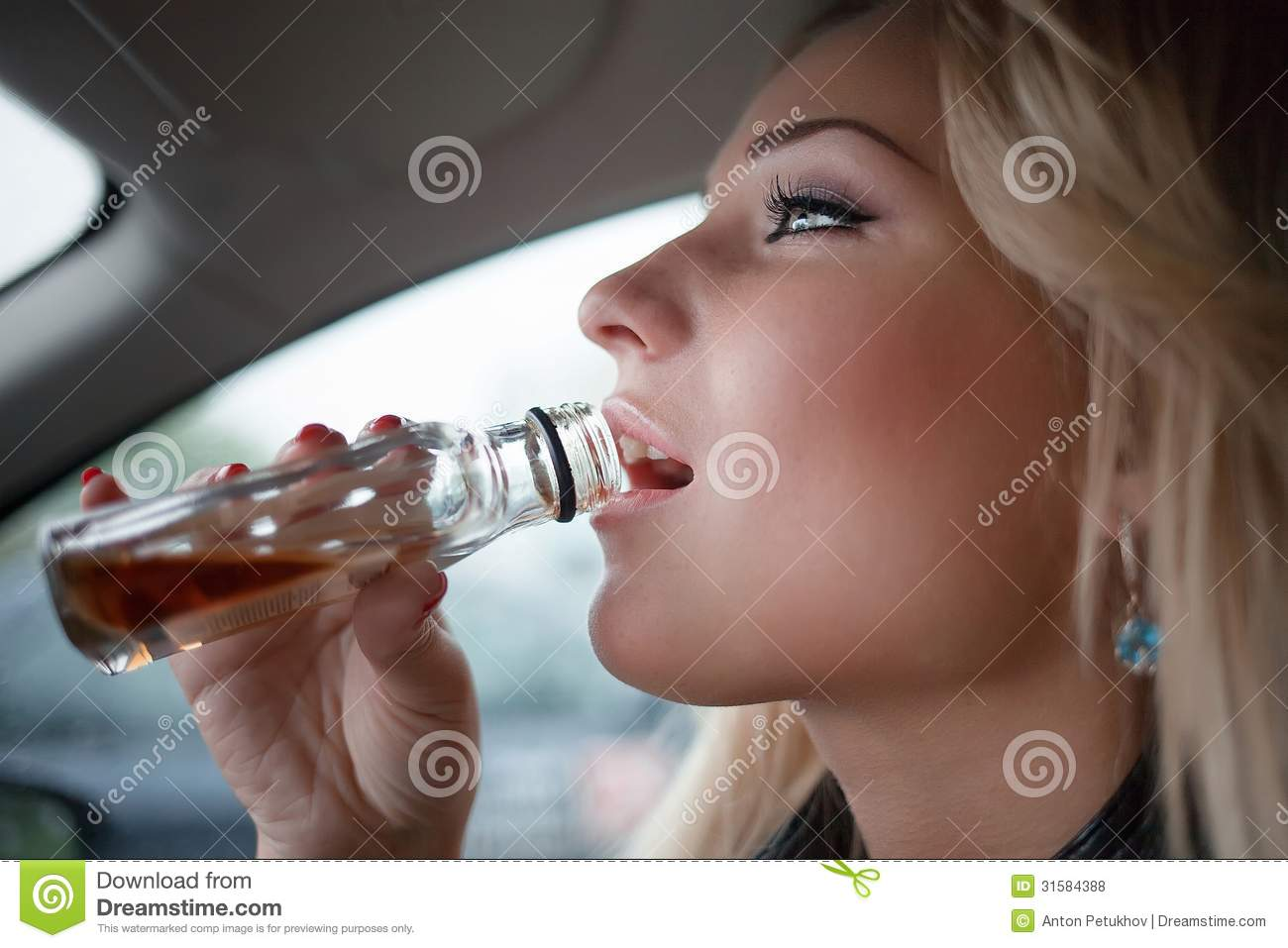 Woman Drinking A Bottle Of Whiskey
